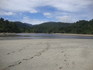 Footsteps on the beach after crossing Big River